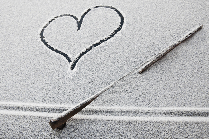 heart on the snow-covered car