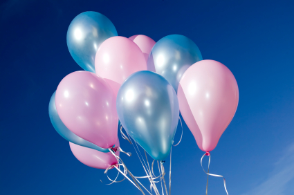 There are colorful balloons on blue sky background