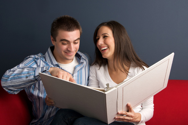 couple looking at romantic photo album gift ideas