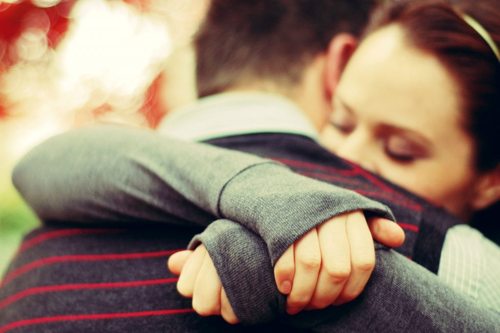 hugging romantic couple coming home welcome home ideas
