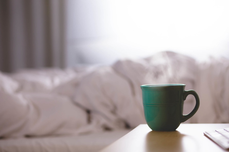 ic-couple-sleeping-in-bed-romantic-rituals-coffee-and-morning-cuddling