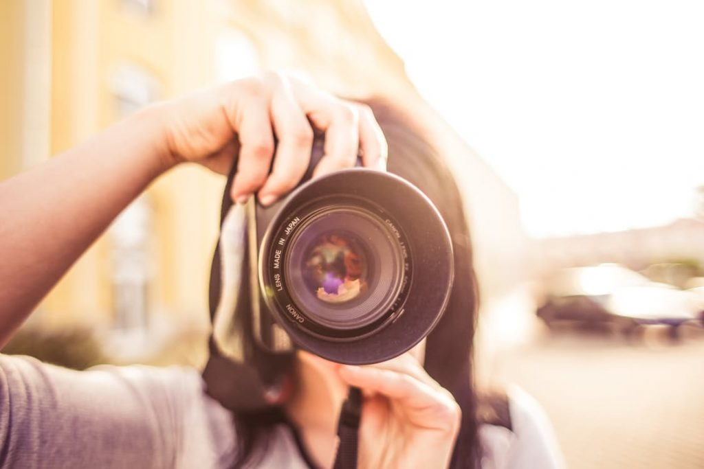 person-taking-pictures-on-camera-romantic-email-internet-ideas