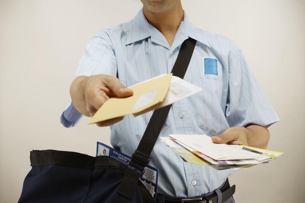 Postman delivering mail