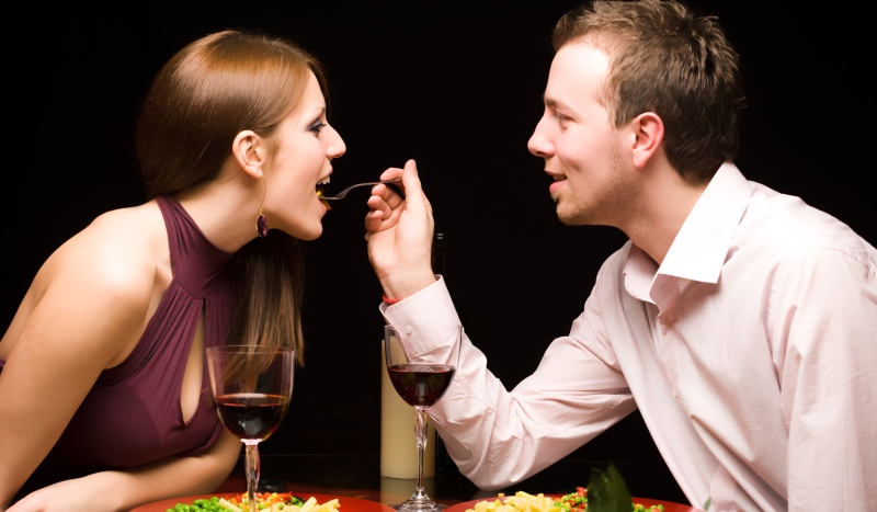 romantic couple sharing food dining experience care package ideas