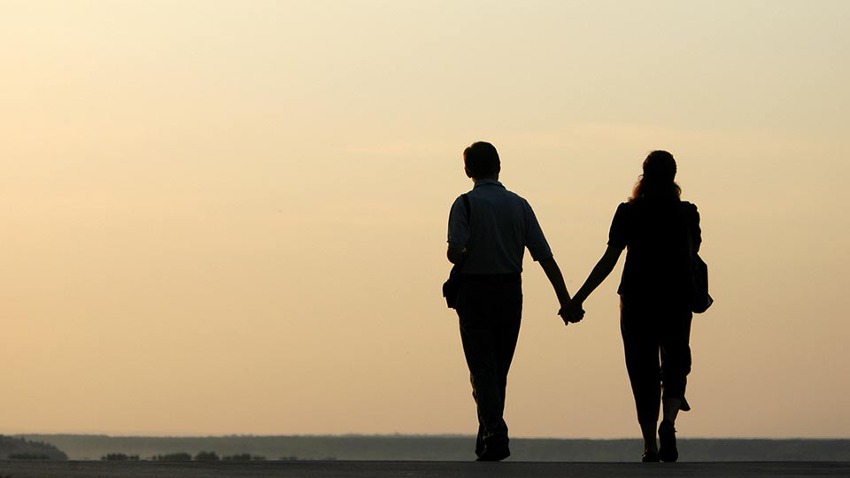 romantic-couple-walking-down-road-out-of-gas-dating-disasters