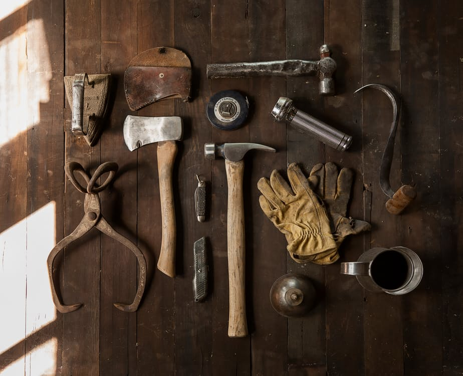romantic-man-using-tools-laid-out-old-style-rustic-puzzle-decorating