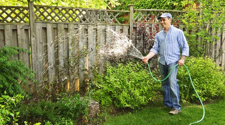 romantic-man-watering-plants-gift-basket-wine-idea