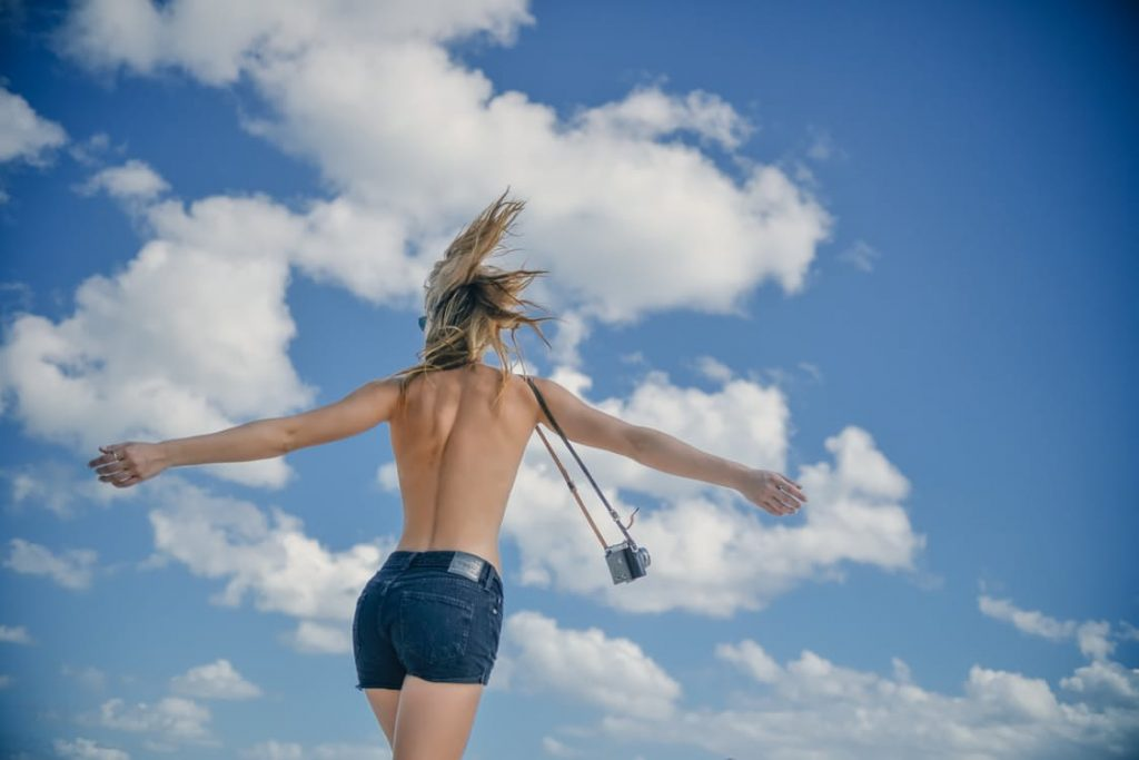 romantic-topless-woman-back-clouds-camera-free-date-ideas-cheap-dates