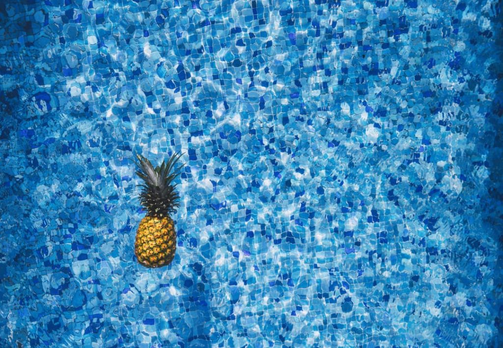 romantic-tropical-resort-vacation-getaway-pineapple-in-pool-mail-idea
