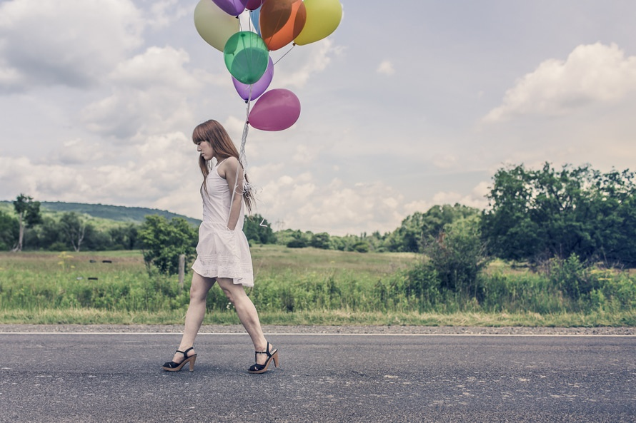 romantic-woman-walking-with-balloons-romantic-dating-ideas-truck-car