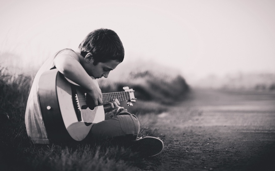 romantic-young-man-playing-guitar-child-kid-romantic-song-exchange