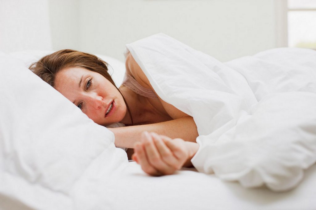 sick woman in bed romantic coffee tea helping pain relief