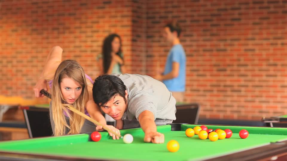couple playing billiards romantic first date ideas