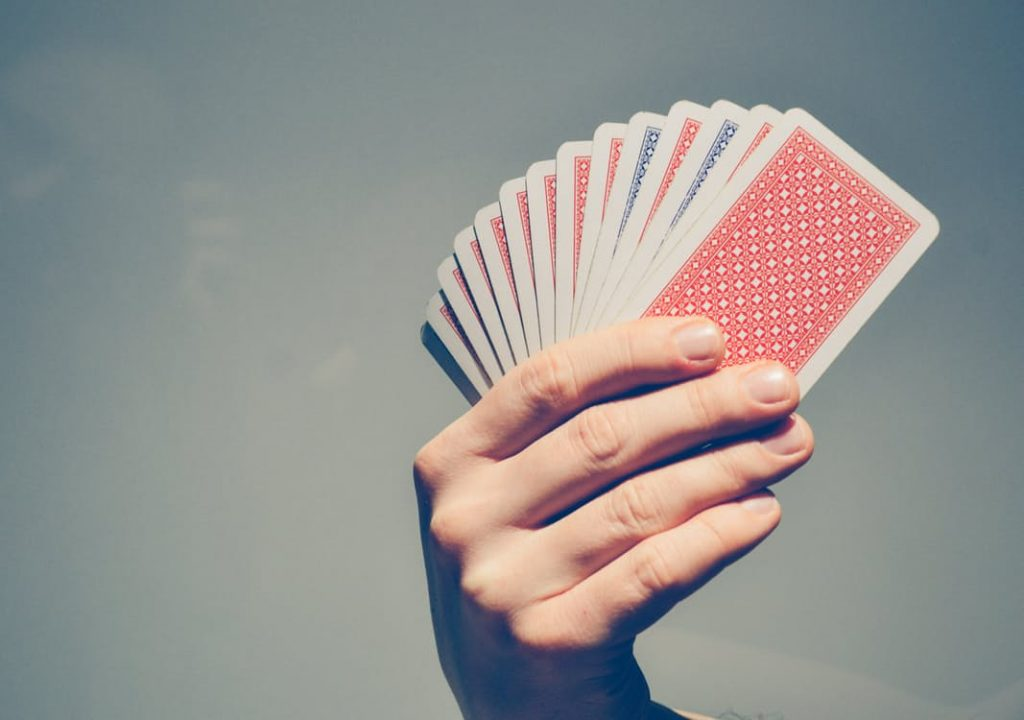 romantic-man-holding-cards-in-hand-dating-ideas-uno-game